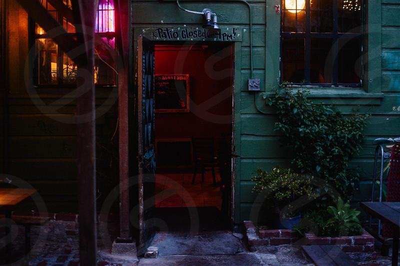 red steel gate beside window photo