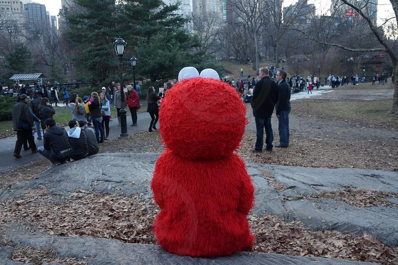 elmo mascot sitting on park photo