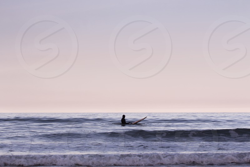 person in silhiouette figure on ocean photo