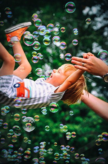 child play fun bubbles action summer fun kid boy parent son family nature trees beauty photo