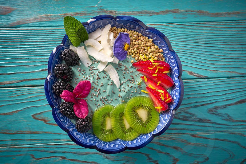 Acai bowl smoothie with kiwi blackberry strawberry and chia seeds photo