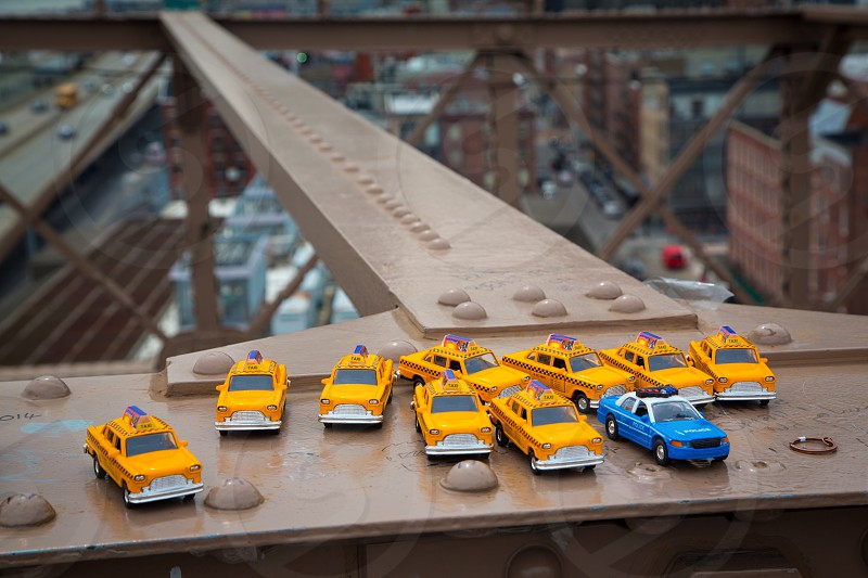 A Souvenir Stall on Brooklyn Bridge NYC Brooklyn bridge NYC souvenirs stall souvenir toy toys cars taxi cabs police market vendor street tacky tourism tourist travel New York City USA United States of America American for sale icon iconic photo