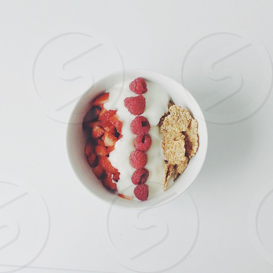 chips and strawberry with cream in white ceramic bowl photo