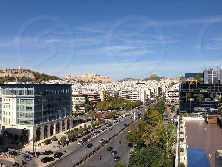 City view of Athens Greece. Syngrou Avenue the acropolis & Lycabettus Hill in the distance photo