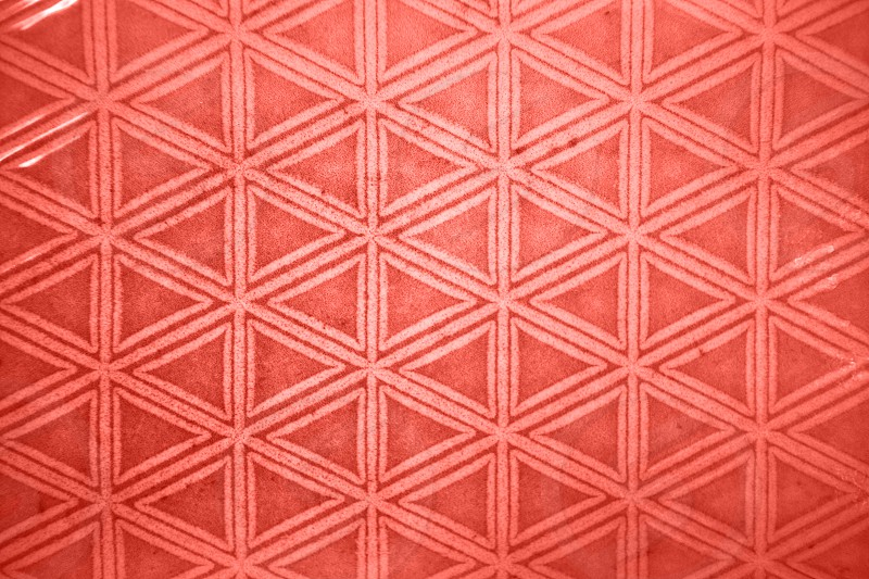 Figured decorative textured pattern of ceramic tiles in a trendy color of the year 2019 Living Coral pantone. Can be used for your ideas of design. photo