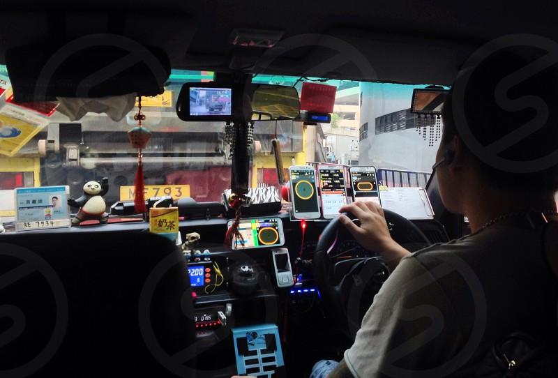 Cluttered dashboard in a HONG KONG high tech taxi. photo