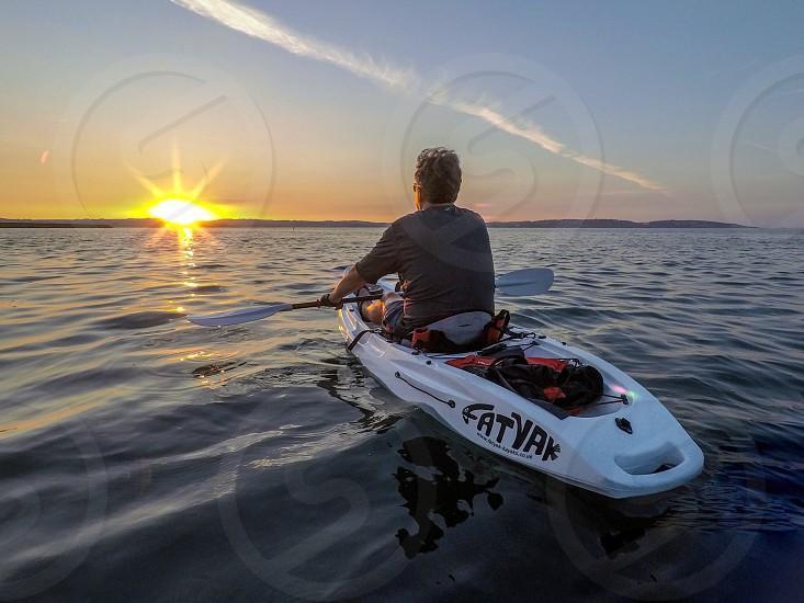 Kayaking kayak freedom sea sunset surf golden hour peace calm inner peace photo