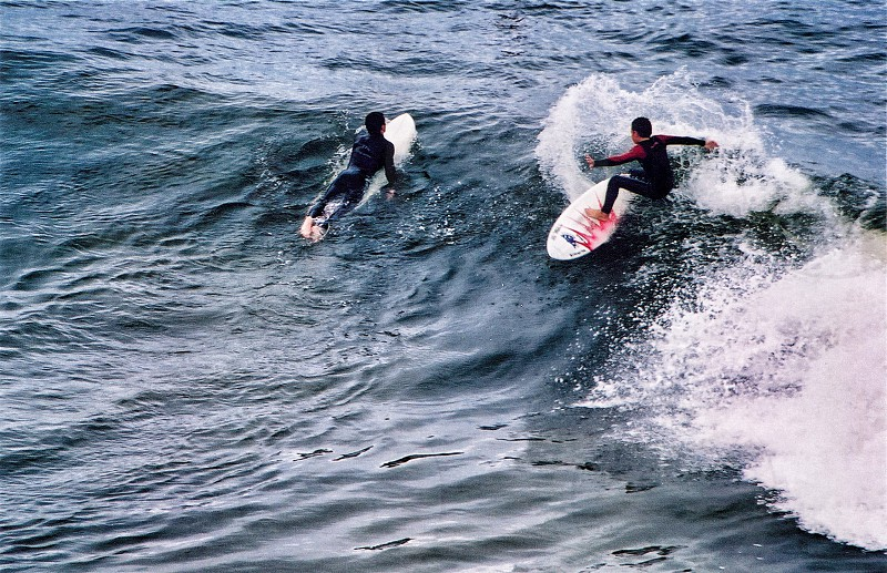 man surfboarding on the beach photo