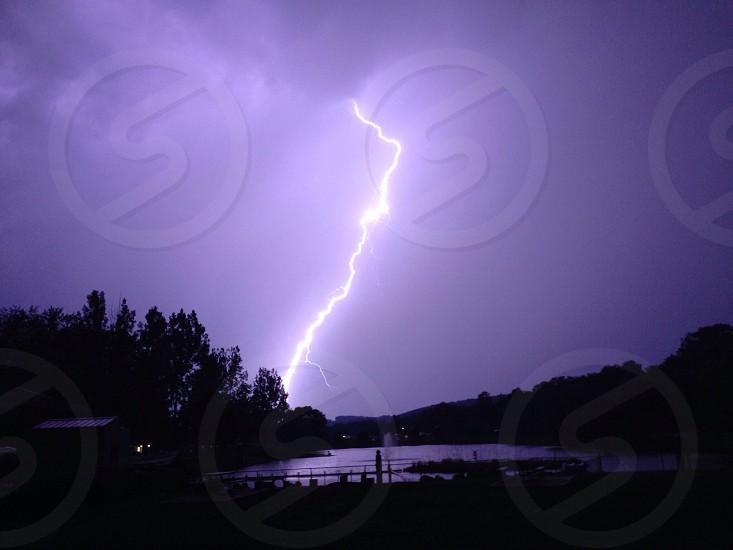 lightning bolt strike thunderstorm rain storm photo