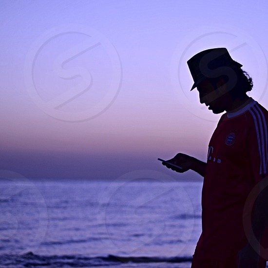 man in red top wearing black bucket hat photo