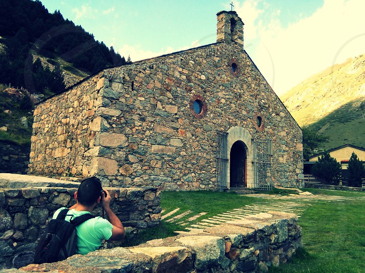 photographer shooting a picture medieval church Nuria Catalonia photo