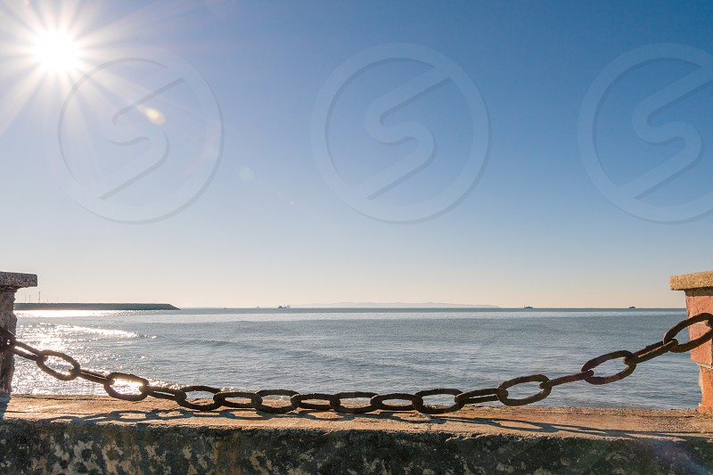 Rusty chain blocking the beach in Durres photo