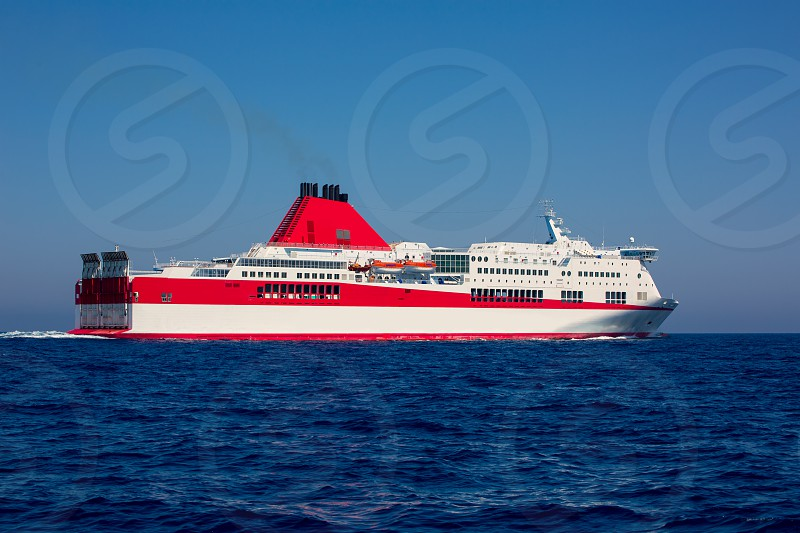 Mediterranean sea curise boat in red and white dolor photo