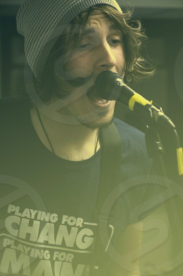 man singing on microphone  photo