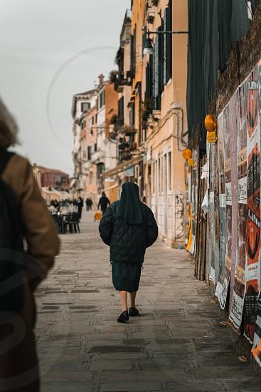 Nun walking on a street photo