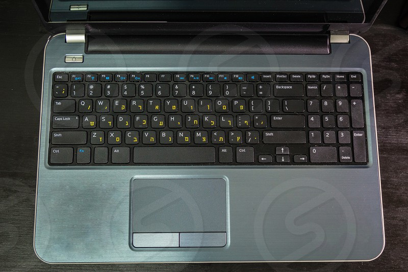 Keyboard with letters in Hebrew and English - Laptop keyboard - Top View  photo