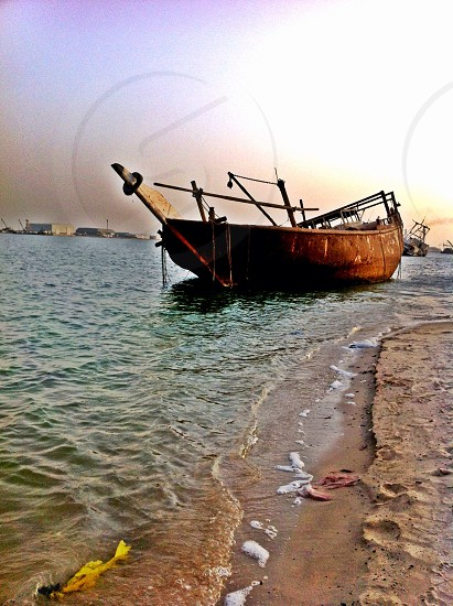 LisAm stranded Boat Fishing Boat water sea beach sand Middle East  photo