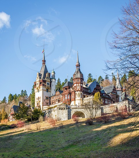 Peleș Castle near Sinaia and the Carpathian Mountains in a sunny day. Transylvania Romania photo
