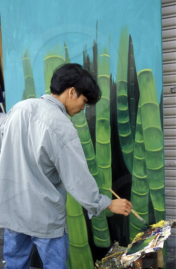 copy Art painter at a market in the city of ho chi minh city in Vietnam photo