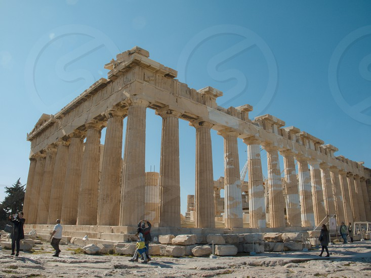 Wide angle of Parthenon Temple daytime. Tourists Greece travel europe blue sky Low angle  photo