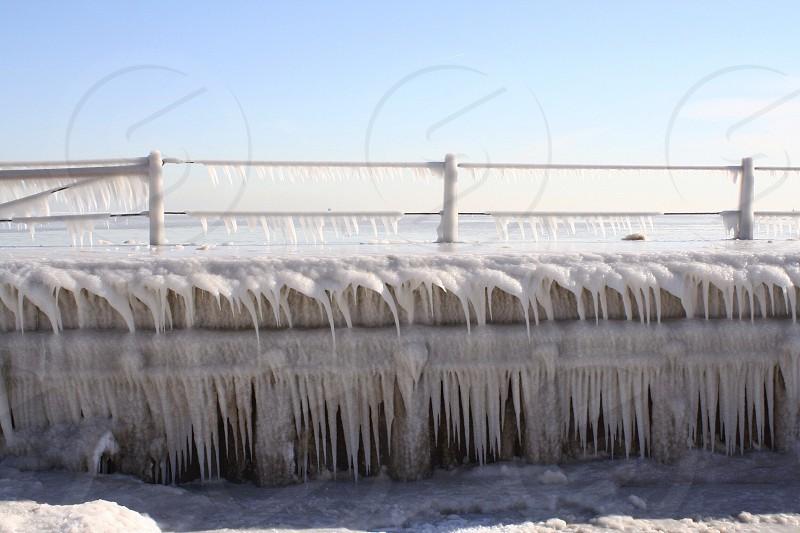Ice beach water Lake Michigan winter patterns photo
