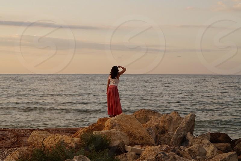 Destination travel trip vacation explore scenic sea ocean summer waves beach female woman looking sky horizon seaside Europe Black Sea  photo