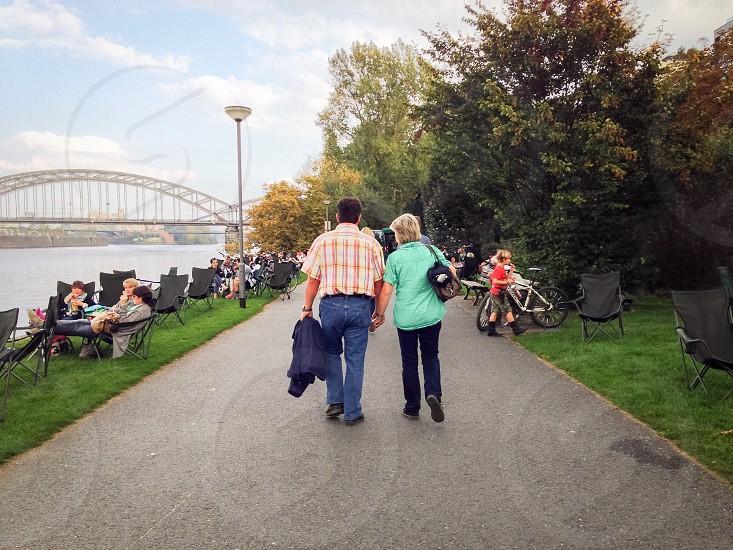 Couple is walking along Main river photo