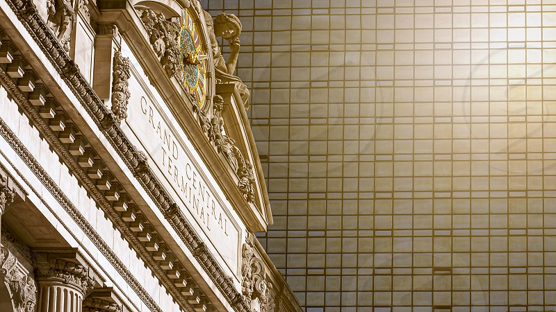 New York USA November 2016: exterior of the Grand Central Terminal in New York with the large clock surrounded by the statues of the Greek gods Minerva Hercules and Mercury photo
