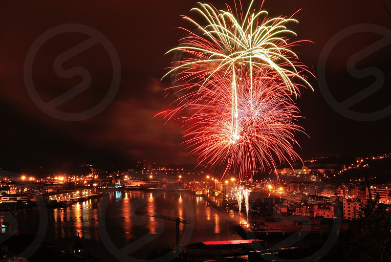 fireworks display over body of water during nighttime photo