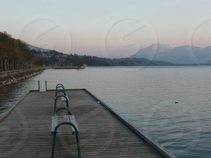 Evening light over the water and mountains from the jetty at Lake Bourget France photo