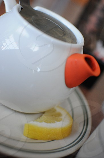 Teapot with lemon photo