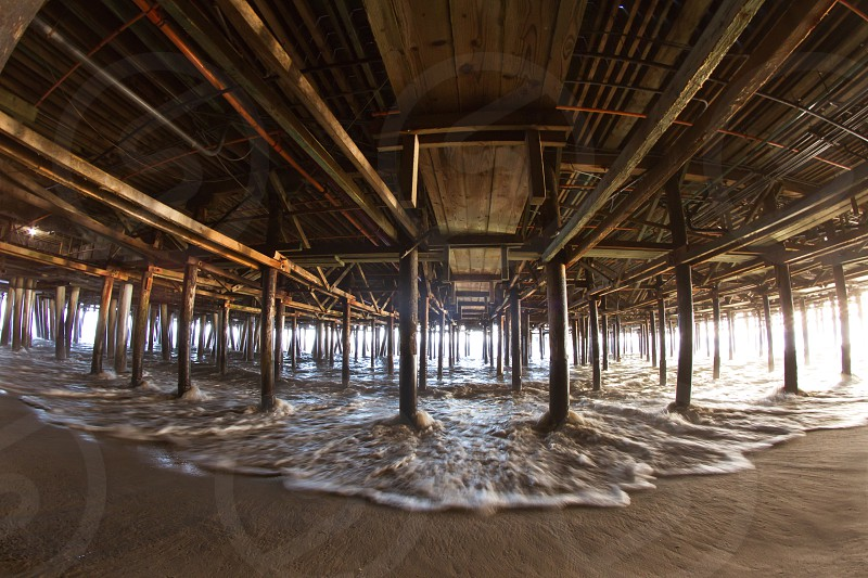 Fisheye view from underneath the pier in Santa Monica California. photo