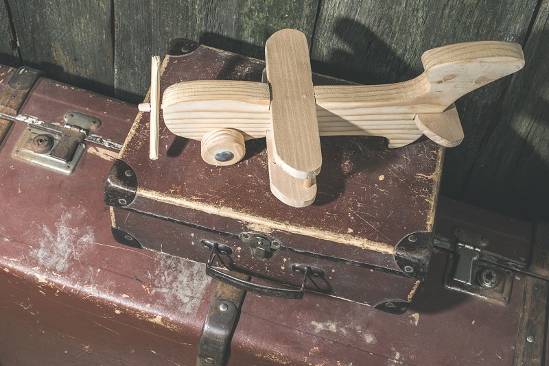 Children's toy wooden airplane. Vintage style. photo