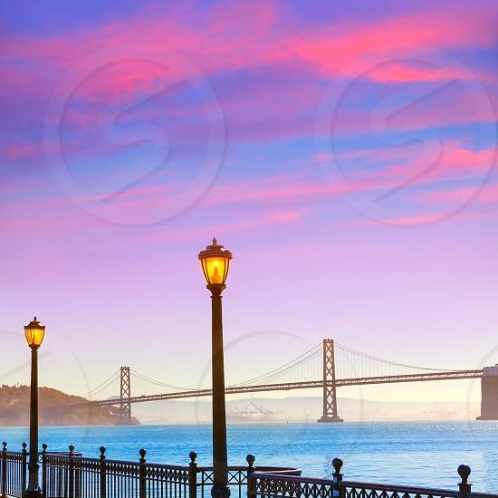San Francisco Bay bridge from pier 7 in California sunset USA photo