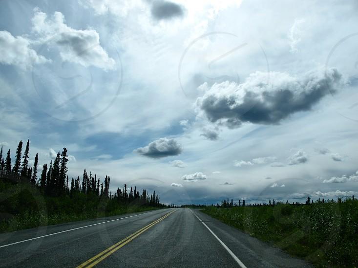 ALASKA TRAVEL ON THE ROAD BEHIND WINDSHIELD photo