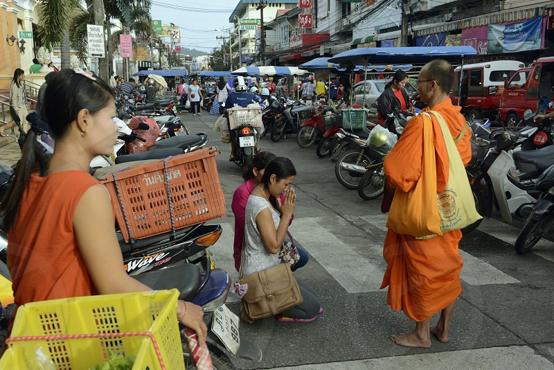 people praying at the day Market in the city of Phuket on the Phuket Island in the south of Thailand in Southeastasia.