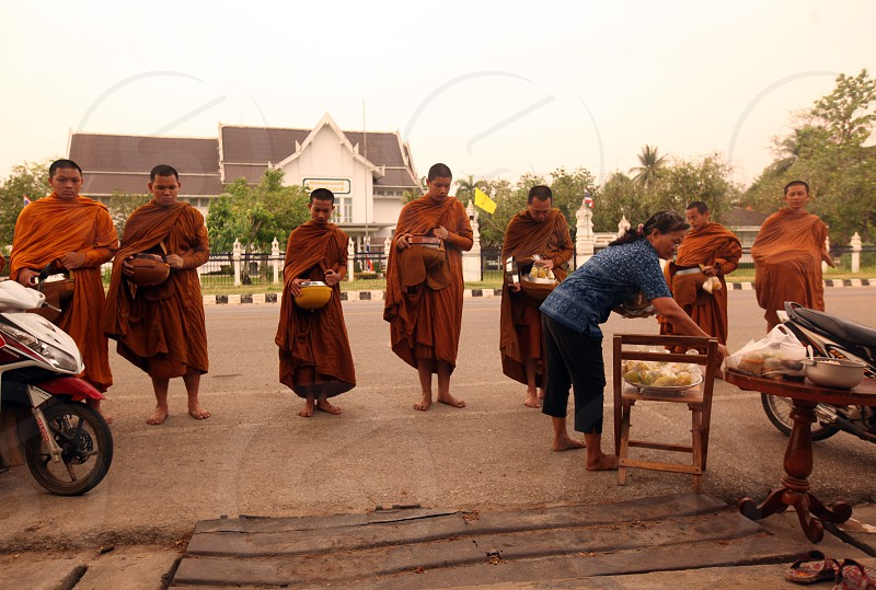 monks in the morning in the old town of  Sukothai in the Provinz Sukhothai in the north of Bangkok in Thailand Southeastasia. photo