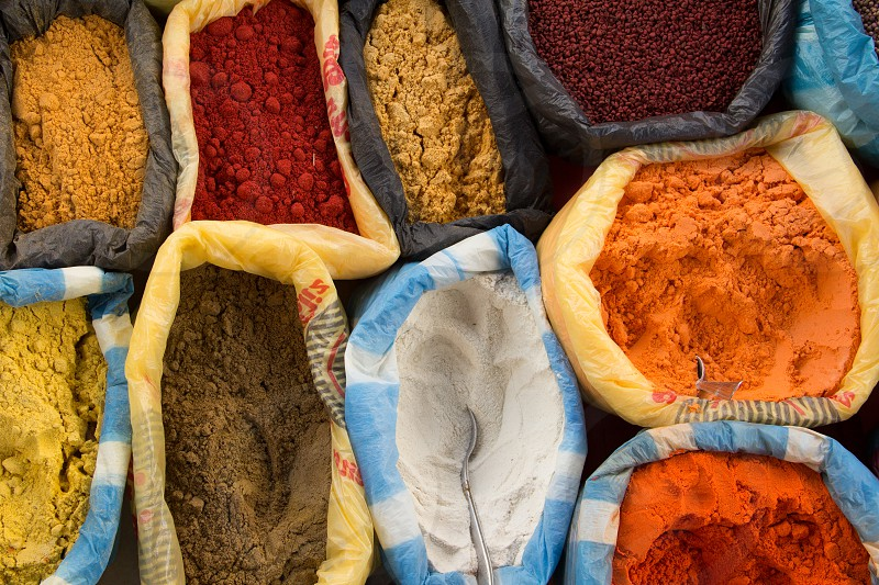 Assortment of spices for sale at the central market in Otavalo Ecuador. photo
