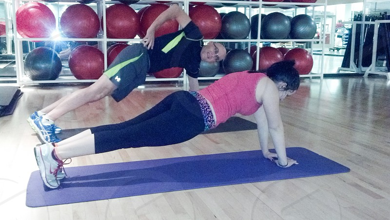 Man and woman exercising doing push-ups photo