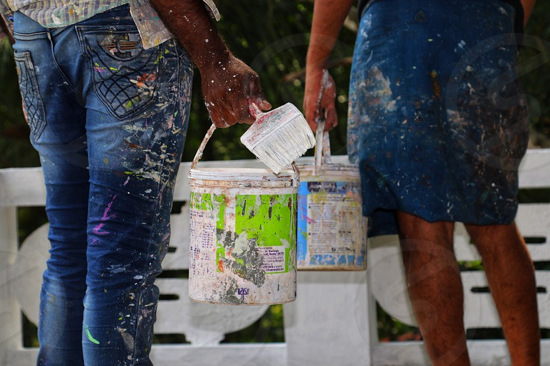 Two painters with two paint buckets  photo