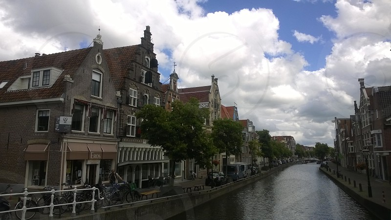 Netherlands Europe Alkmaar Bridge Houses Architecture Clouds Sky Travel Canal River Water photo