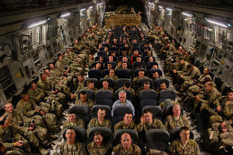 Although you may not feel it. This is the most emotional shot from my deployment to Afghanistan. The emotion on each soldiers face is one of happiness anger and relief as we packed up on our last flight at Bagram AFB in Afghanistan!  photo