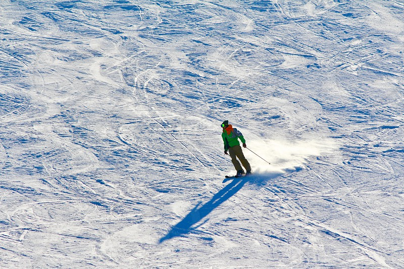 People on the snow skiing on snow in a beautiful winter sunny day photo