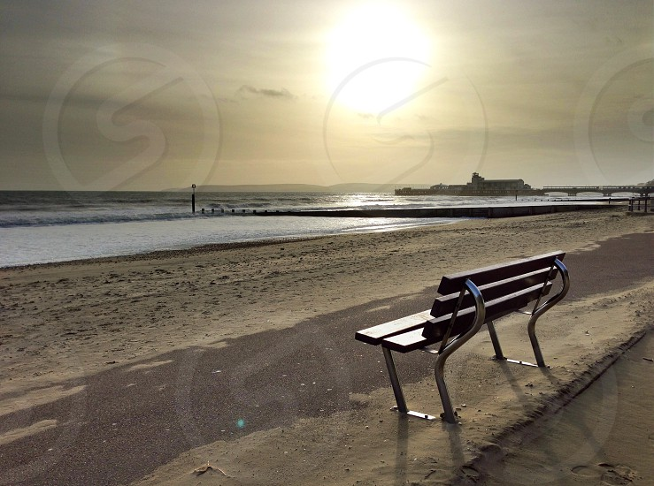 brown wooden bench chair near sea photo