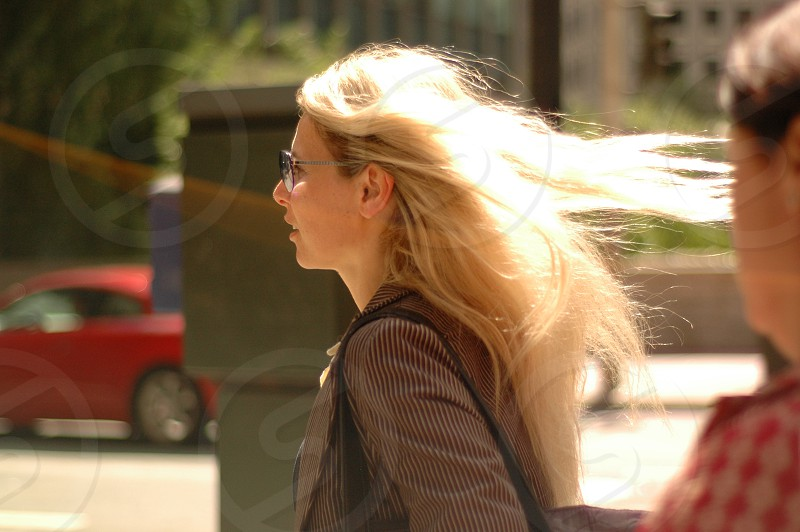 business woman motion action street road san francisco California business hairs jacket sun glass blonde photo