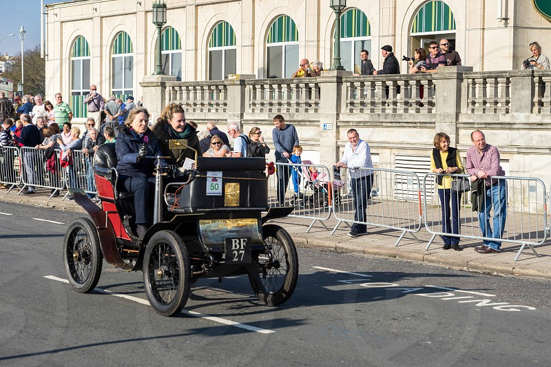 Car approaching the Finish Line of the London to Brighton Veteran Car Run photo