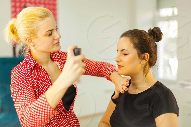 Makeup in beauty salon by woman photo