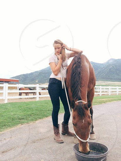 feed horse girl cowgirl farmer farm ranch Utah rural mountains photo