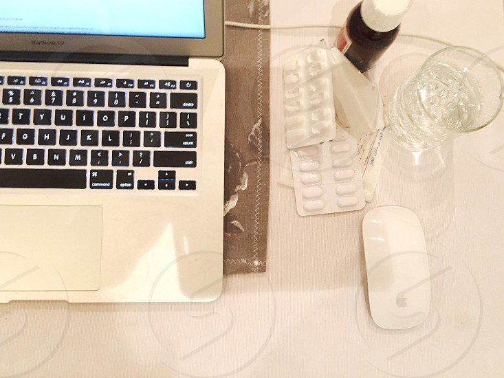 macbook air and apple white wireless magic mouse photo