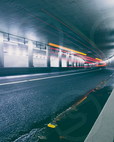 time lapse photography of concrete tunnel road path photo